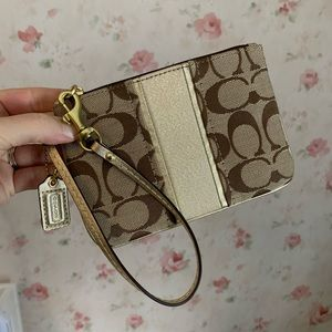 Brand new Coach wristlet and matching wallet